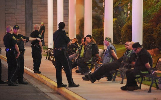 In this Sept. 23, 2011, file photo, police officers keep an eye on handcuffed men at the east entrance to John Ascuaga's Nugget hotel-casino after a shooting in Sparks, Nev.