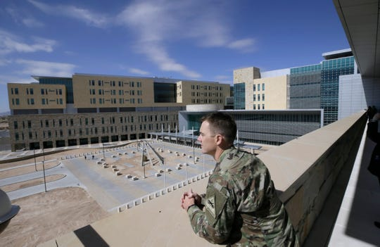 Maj. Jeff Ashburn looks out at the new William Beaumont Army Medical Center in far east El Paso from a second story balcony. The construction has been completed and will be turned over to hospital officials. They expect to begin seeing patients in late September.