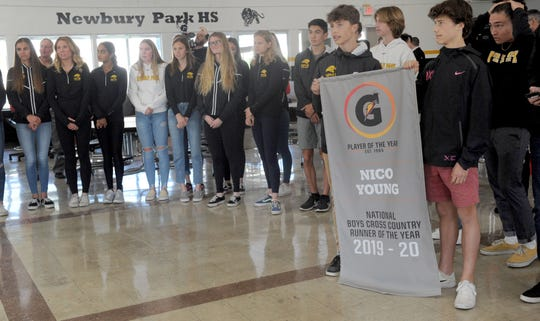Leo Young and Lex Young hold the sign for their older brother Nico Young, who received the Gatorade Boys Cross Country Runner of the Year award at Newbury Park High on Thursday morning.