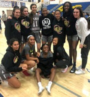 The Oaks Christian girls basketball team pose for a photo after its loss to host Bishop Amat in a CIF-SS Division 2A quarterfinal game Wednesday night.