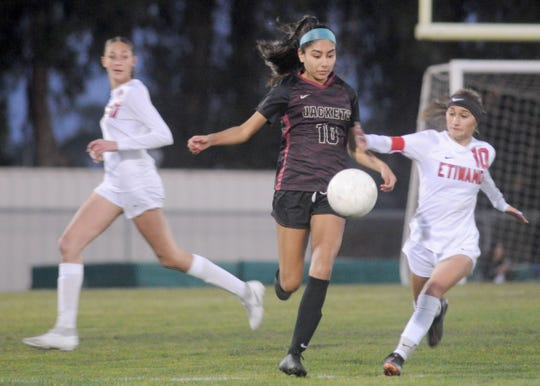 Oxnard's Val Gutierrez keeps her eyes on the ball during the Yellowjackets' victory over Etiwanda in a CIF-SS Division 3 quarterfinal match on Wednesday night.
