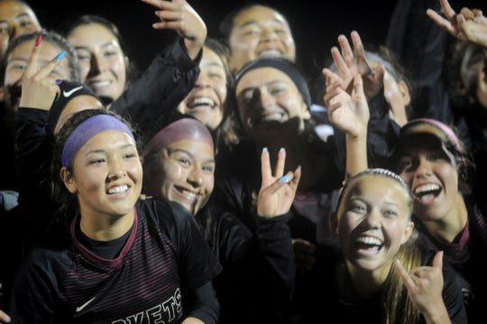 The Oxnard High girls soccer team celebrates after winning a shootout against Etiwanda in a CIF-SS Division 3 quarterfinal match on Wednesday night.