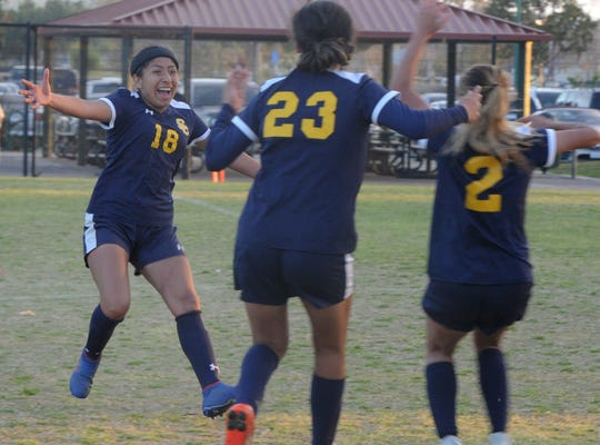 Santa Clara's Alondra Sanchez celebrates with Emily Ordaz (23) and Autumn Clark (2) after scoring the winning penalty kick against Milken in a CIF-SS Division 7 quarterfinal match Wednesday at College Park in Oxnard.