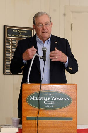 Dan Wells, a former U.S. intelligence officer, speaks to the Millville Woman's Club during a recent meeting.