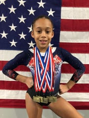 Ja'Zyra Sharp from Star Bound Gymnastics Academy captured an all-around state championship title for her age group: Xcel Silver 2020 State Champion.