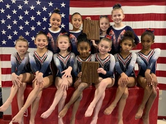 Gymnasts from Star Bound Gymnastics Academy in Upper Deerfield competed successfully in a state championship competition on Feb. 8. Gymnasts pictured are: (front row, from left) Alaina West, Emily Velez, Sophia Melnick, Kemora Thomas, Kimmie Sieminski, Emmani Sanders and Kayla Nichols; and (back row, from left) Aubree Carroll, Ja'Zyra Sharp, Calypso Chavanne and Ava Melnick. Gymnasts Jolea Tharp, Lilah Alvarez and Corinne Cocking are not pictured.