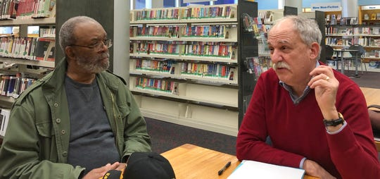 Charles W. Dickerson Fife, Drum and Bugle Corps member Al Thomas, left,  and public historian Robert Wechsler at the New Rochelle Public Library where an exhibit about the corps is on display.