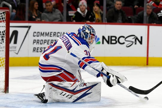 New York Rangers goalie Igor Shesterkin (31) of Russia, makes a save during the first period of an NHL hockey game against the Chicago Blackhawks Wednesday, Feb. 19, 2020, in Chicago.