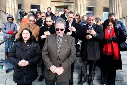 Thomas Carey, president of the Westchester-Putnam Central Labor Body, center, leads a moment of silence during a Feb. 20 vigil in front of New Rochelle City Hall for Alejandro Manuel Caisaguano Pellisa.