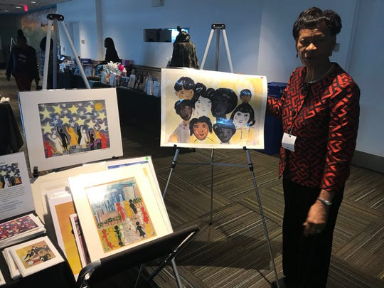 Eunice LaFate of LaFate GalLery LLC. poses with her artwork at Barclays Black-Owned Small Business Expo.