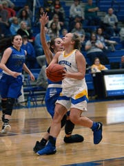 Jayda McGarvey drives into the lane during Maysville's 68-29 win against visiting Zanesville on Tuesday night in a Division II sectional game in Newton Township.