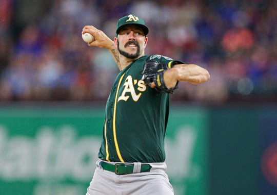 Oakland Athletics starter Mike Fiers (50) throws against the Texas Rangers at Globe Life Park in Arlington.