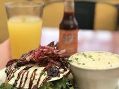Looking for the perfect foodie travel inspo? Yelp narrowed down the cities that had the highest restaurant ratings from out-of-towners to help hungry travelers find the perfect place to eat in 2020. Scroll through to see the five top foodie destinations and a sampling of their top-rated resturants, starting with Asheville, North Carolina, which is home to the popular Sunny Point Café.