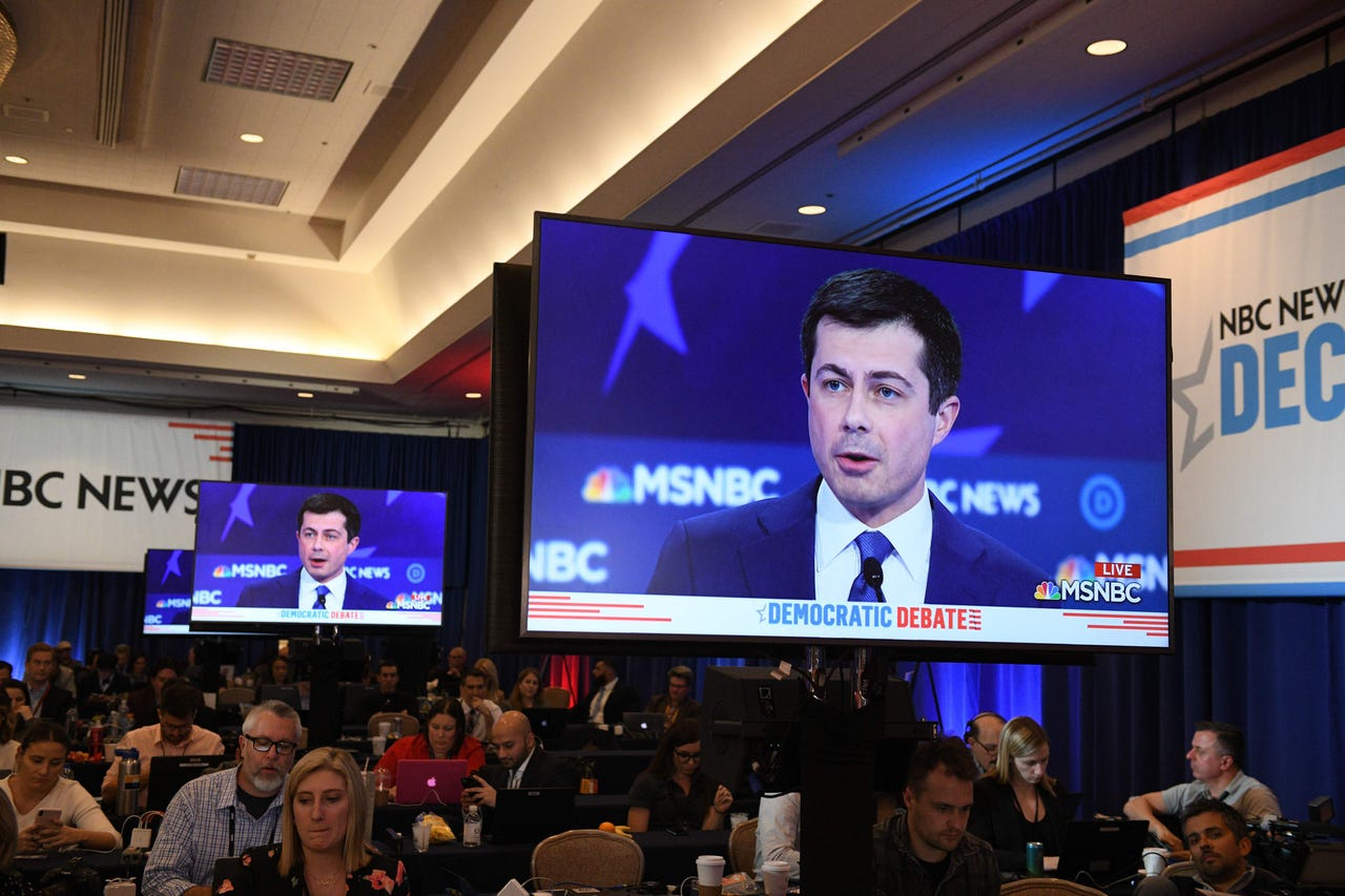 Democratic presidential hopeful Mayor of South Bend, Indiana, Pete Buttigieg is seen on a screen in a media room.