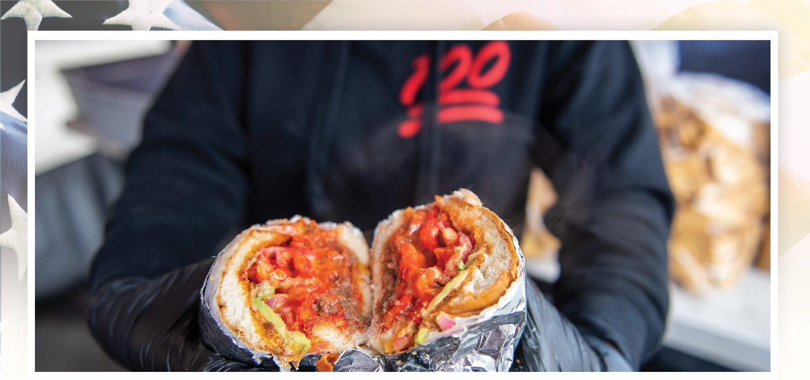 An employee of Orlando Osornio, owner of Tortas Al 100, in Salinas, California, holds the Don Cheeto on Feb. 08, 2020. Osornio's Don Cheeto is one of the most popular items on his menu.