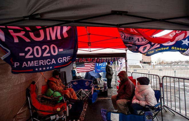 """""""Trump's Front Row Joes"""" group are first in line outside the Broadmoor World Arena in preparation for President Donald Trump's Colorado Springs campaign rally in Colorado Springs, Colo., on Wednesday, Feb. 19, 2020."""