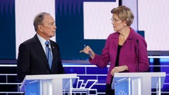Democratic presidential candidates, former New York City Mayor Mike Bloomberg, left, and Sen. Elizabeth Warren, D-Mass., talk before a Democratic presidential primary debate Wednesday, Feb. 19, 2020, in Las Vegas, hosted by NBC News and MSNBC.