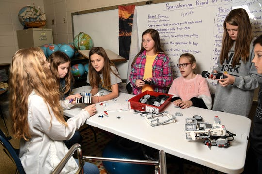Catherine Gray, left, Kyley Wiles, Anna Kathryn Bowen, Kaylee Sonefelt, Gracie McGee, Kaitlyn Norris, and Campbell Jordan during after school practice for the Starr Elementary Tigerbots robotics team.