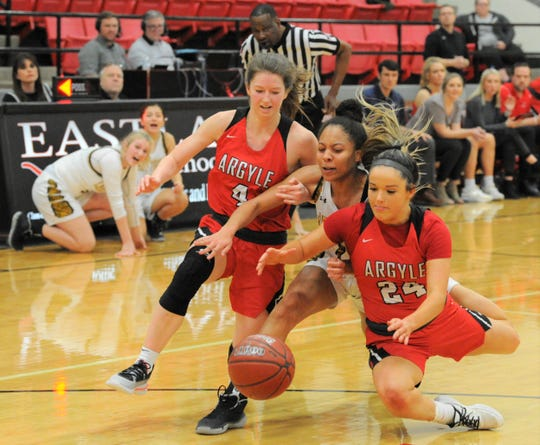 Snyder junior Kamiah Davis chases a loose ball along with Argyle players Bailey Timmons (4) and Abby Williams (24) in a Region I-4A area playoff on Thursday, Feb. 20, 2020, at Eastland High School's Marshall Gym.