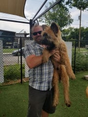 Ben Mixson with one of his beloved dogs.