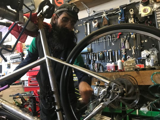 Rod Luitjen said his commute by car from his family farm in the Big Laurel community to his bike shop on Main Street in Marshall now takes 30-minutes longer after the Walnut Creek Road landslide.