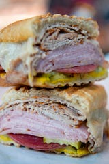 The Tampa deli sandwich at New York Butcher Shoppe in South Asheville is made with ham, roast pork, salami and provolone cheese hot pressed on Cuban bread.