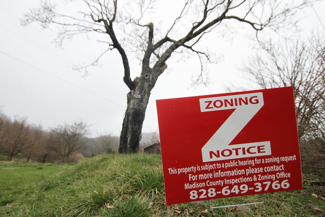 A sign at the entrance of the Mulberry Gap Farm informs neighbors of zoning issues with the planned retreat center.