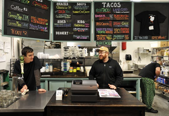 White Duck Taco owner Ben Mixson, right, and employee Jon Hency, in 2011, the year White Duck opened and Mixson married Laura Reuss.