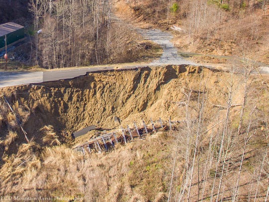 Aerial images show the damage to Walnut Creek Road from a landslide that first materialized Feb. 14.