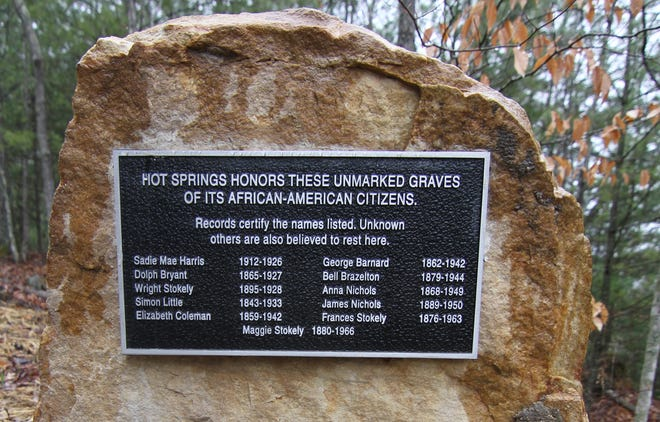 A plaque lists the names of African American residents of Hot Springs known to be buried at Odd Fellows Cemetery.