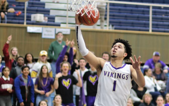 North Kitsap's Shaa Humphrey heads to the basket in double overtime during the Vikings' West Central District boys basketball semifinal game against White River. The Vikings won 66-59.