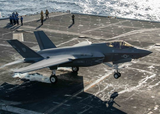 """An F-35C Lightning II, from the """"Rough Raiders"""" of Strike Fighter Squadron (VFA) 125, performs touch and go landing of the aircraft carrier USS Nimitz Jan. 18. Nimitz returned to Bremerton Friday."""