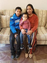Vilma Diaz photographed with her two children, 11-year-old Axel and 2-year-old Josue. She will bring them with her to El Salvador when she is deported Saturday.