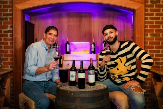 Master Sommelier George Miliotes, of Wine Bar George in Disney Springs, trying out some wines for this year's event with Magic player Evan Fournier, a wine connoisseur.