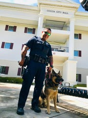 Four Cocoa police K9 officers—including Kyra pictured with trainer Officer Brian Delossantos— got new bulletproof vests this week.
