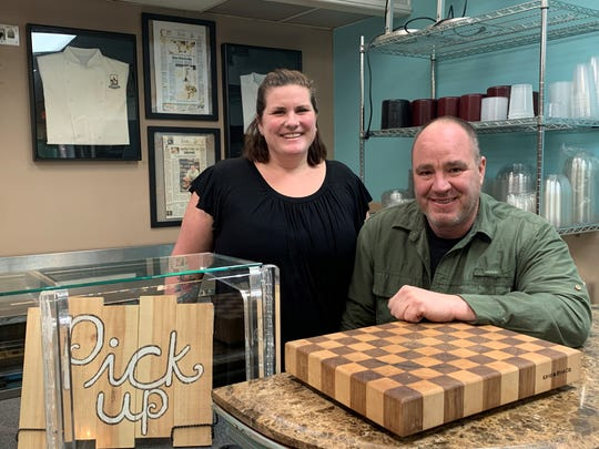 Ridgway Grace and Mark Rooks behind the counter of the new Bleu Bear Market in Marlton.