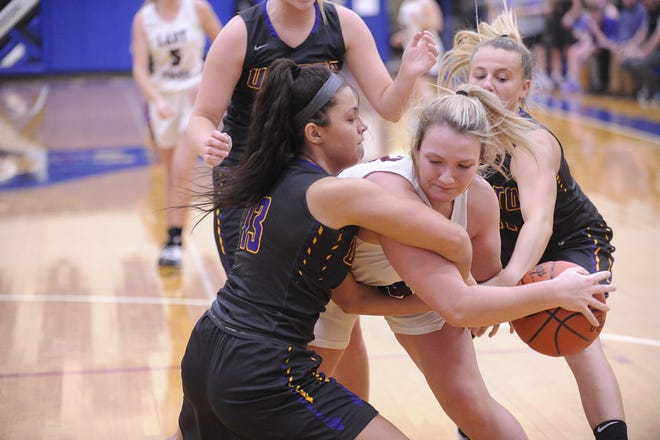 Unioto's Jerzi Paul and Emily Coleman try to possess the ball during a 53-46 loss to Vinton County in a D-II District Semifinal on Thursday Feb. 20, 2020 at Southeastern High School in Chillicothe, Ohio.