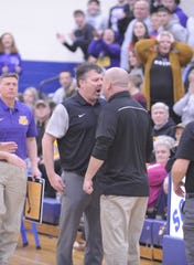 Unioto's Jeff Miller and Vinton County's Rod Bentley go at it during Unioto's 53-46 loss to Vinton County in a D-II District Semifinal on Thursday Feb. 20, 2020 at Southeastern High School in Chillicothe, Ohio.