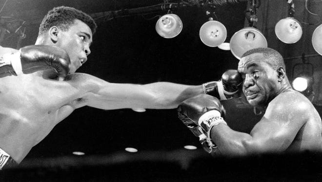 Muhammad Ali, left, then known as Cassius Clay, connects on a punch to the face of Sonny Liston in the third round before a TKO in the seventh round of their heavyweight championship fight in Miami Beach, Fla., on Feb. 25, 1964.