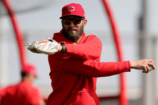 Cincinnati Reds assistant hitting coach Joe Mather (63) loosens to throw during spring practice, Friday, Feb. 21, 2020, at the baseball team's spring training facility in Goodyear, Ariz.