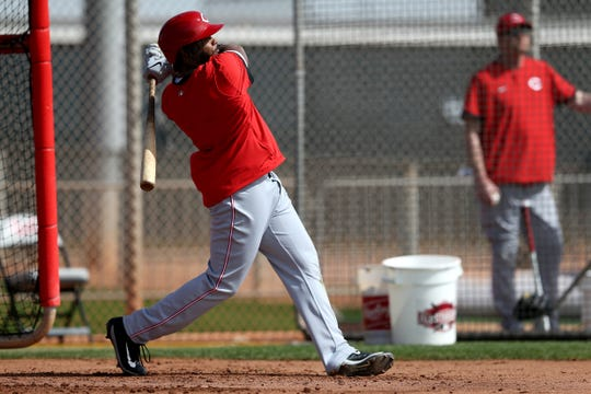 Cincinnati Reds right fielder Phillip Ervin (6) follows through on a home run swing during live batting practice, Friday, Feb. 21, 2020, at the baseball team's spring training facility in Goodyear, Ariz.