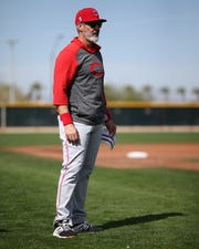 Cincinnati Reds hitting coach Alan Zinter (59) observes live batting practice during spring practice, Friday, Feb. 21, 2020, at the baseball team's spring training facility in Goodyear, Ariz.