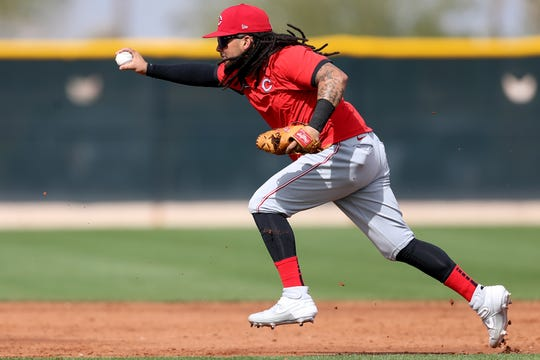 Cincinnati Reds shortstop Freddy Galvis (3) participates in rundown drills, Friday, Feb. 21, 2020, at the baseball team's spring training facility in Goodyear, Ariz.