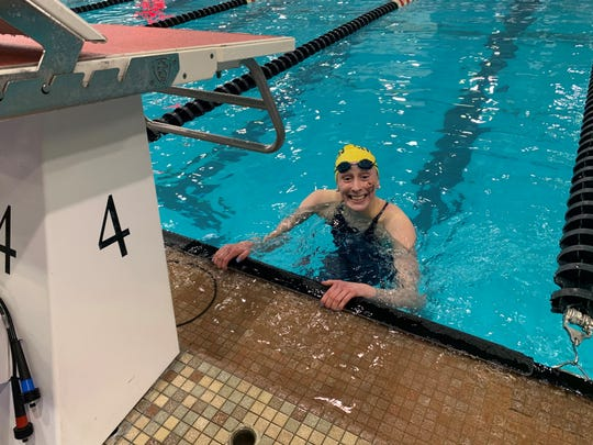Ella Jo Piersma from Seven Hills in the pool after winning the 200 Free state title Feb. 21.