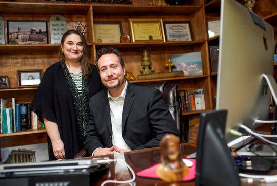 Daniel and Michelle Ramsey pose for a portrait behind Daniel Ramsey's desk where he operates the remote streaming operation for All Nations Biblical Study Center at First Assembly of God in Clarksville, Tenn., on Thursday, Feb. 6, 2020.