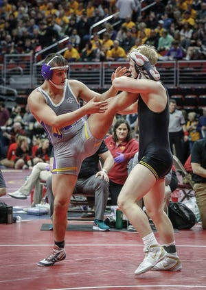 Southeast Polk senior Gabe Christenson scores a takedown against Indianola senior Miles Berg in their match at 195 pounds during the 2020 Iowa high school state wrestling tournament at Wells Fargo Arena in Des Moines on Friday, Feb. 21, 2020.