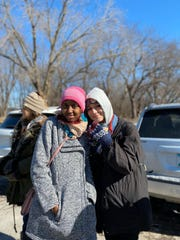 Ifrah Muhumed, 22, Abdullahi Sharif's sister, and her friend Tess Conway, 21, at the search party for Abdullahi Sharif on Feb. 21, 2020.