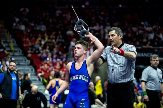 Underwood's Blake Thomsen advances in the Class 1A Iowa high school state wrestling tournament after beating Sigourney-Keota's Jack Clarahan at 152 during the opening round of the state wrestling tournament on Thursday, Feb. 20, 2020, at Wells Fargo Arena in Des Moines.