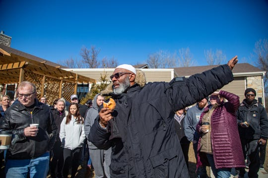 """Ako Abdul-Samad speaks to volunteers before a search for Des Moines teen Abdullahi """"Abdi"""" Sharif, Friday, Feb. 21, 2020 near the area his cell phone last pinged a tower. He has now been missing for over a month."""