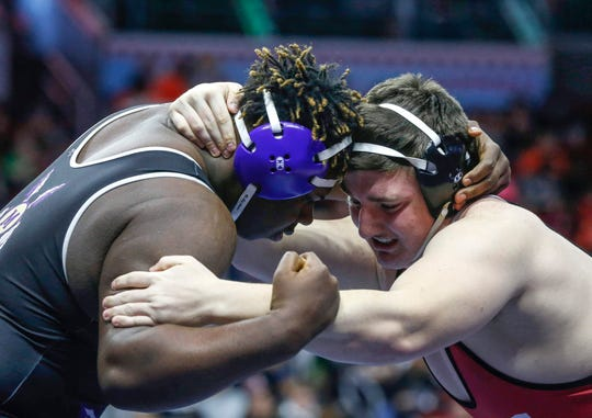 Muscatine junior Togeh Deseh ties up with Western Dubuque's Jonathan Savolt in their heavyweight match in Class 3A during the 2020 Iowa high school state wrestling tournament at Wells Fargo Arena in Des Moines on Friday, Feb. 21, 2020.